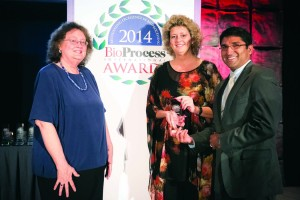 Satish Nadig and Ann-Marie Broome accepting for ToleRaM from BPI editor in chief, Anne Montgomery