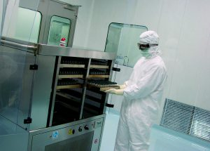 A Patheon employee at work in Swindon, UK