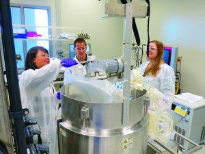 Photo 1: Short course participants learn about disposable bioreactors at BTEC.