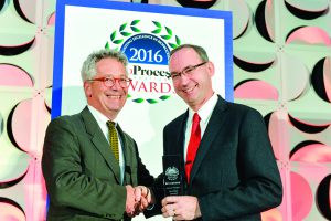 Mark Petrich (Merck's director of component engineering) accepts BPI's 2016 Industry Champion award from James Vogel (The BioProcess Institute's founder).