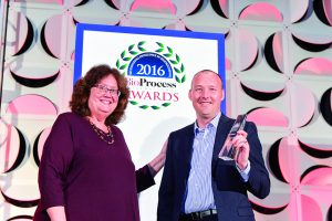 Simon Saxby (Stratophase) accepts the upstream technology award from BPI's Anne Montgomery