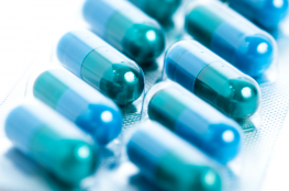 Blue capsules on a white background