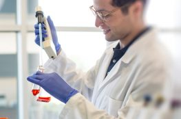 scientist handling equipment